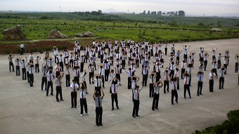 Students at Pyongyang University of Science and Technology doing morning exercises. PUST, 2011