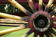 """Wooden Wagon Wheel,"" by Andrew Rollinger https://www.flickr.com/photos/arollinger/"